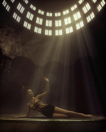 Conceptual photo of lady lying in the old temple