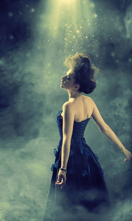 Glamour woman dancing in the fogg Stock Photo
