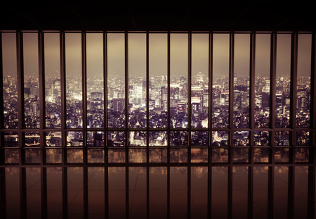balcony window: Night city behind the metal grating Stock Photo