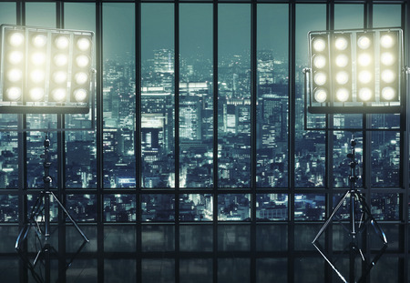 view through: Two huge reflectors and the night city in the background  Stock Photo