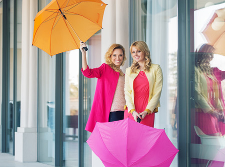 Cheerful ladies posing with the colorful umbrellas photo