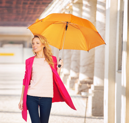Smiling smart lady with the umbrella photo