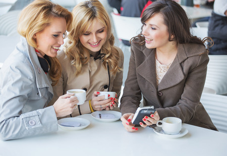 Female friends at the cofee break Stock Photo
