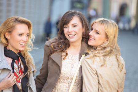 feeling happy: Three young beautiful women smiling