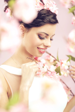 Glad brunette woman with the flowers in hair photo