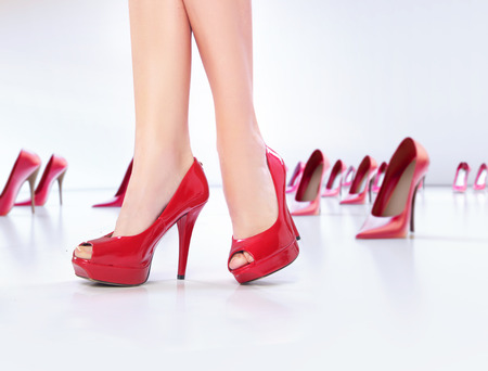 Pretty legs on the red high-heel shoes photo