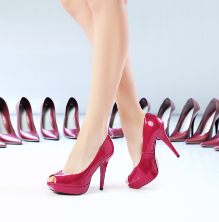 Pretty female feets on the high-heel shoes photo