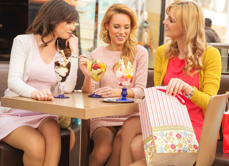 Attractive ladies in the luxury shopping mall Stock Photo