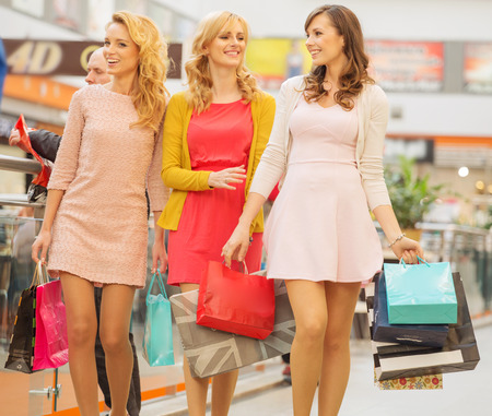 Group of cheerful girlfriends at the shopping photo