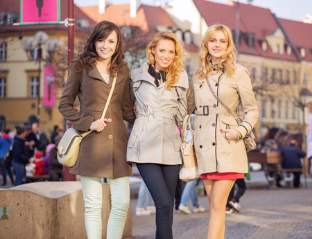 Three smart women in the downtown photo