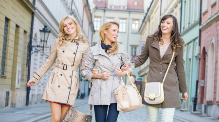 Young female friends walking and laughing Stock Photo - 26865074