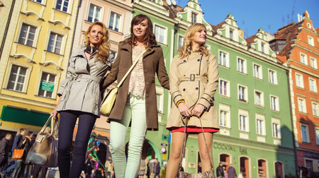 Group of female friends in the crowdy downtown Stock Photo - 26865087