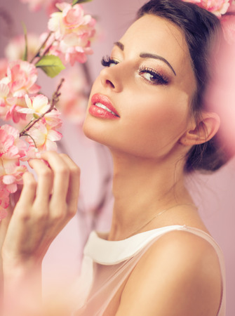 Brunette beautie with the pink flowers photo