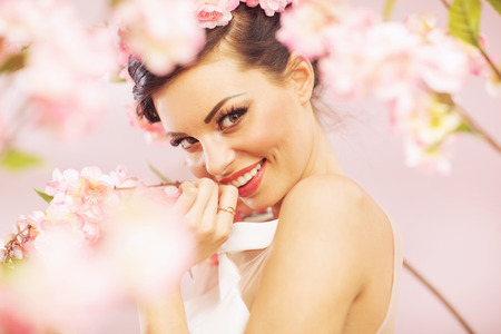 Glad smiling lady with flowers in hair