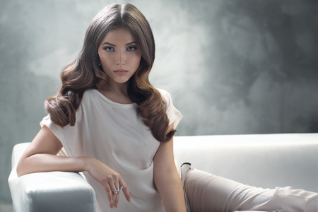 Elegant young lady with excellent classic hairstyle Stock Photo
