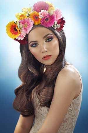 Young pretty girl with the colorful flower hat photo
