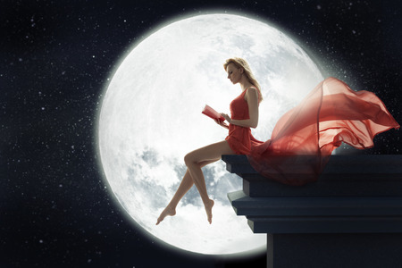 over the moon: Cute lady over full moon background