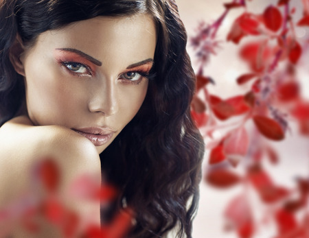 Sensual brunettewoman over the petals background photo