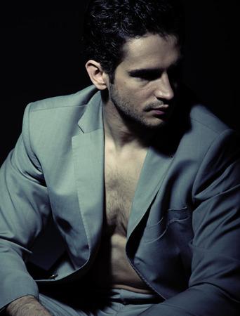 Serious muscular guy wearing suit