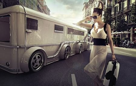 shades of grey: Attractive businesswoman next to the limousine Editorial