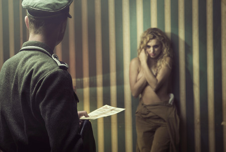 female soldier: Frightened woman during the interrogation