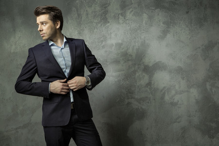 succesful: Succesful young manager wearing black  suit Stock Photo