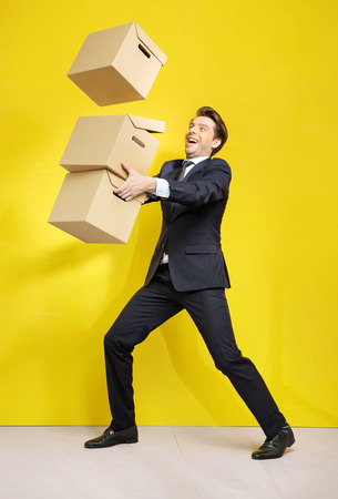 Cheerful businessman with a few paper boxes photo
