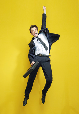 excited: Handsome succesful businessman in the victory jump