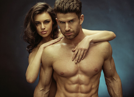 Muscular handsome guy and his sensual girlfriend photo