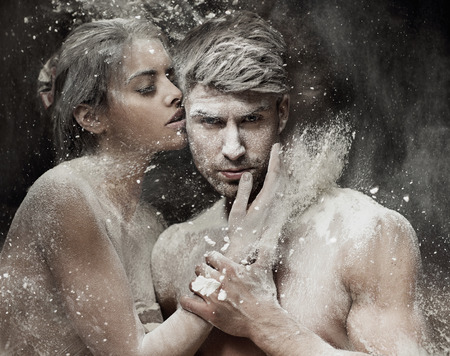 Conceptual photo of the young sand couple photo