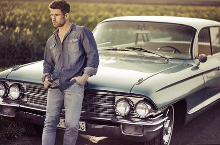 Elegant male model with the blue retro car