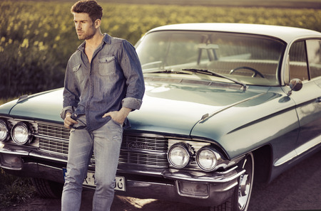 Elegant male model with the blue retro car