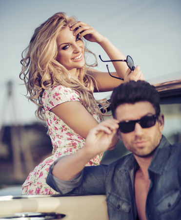 Cheerful blonde woman with handsome boyfriend photo