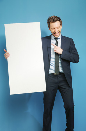 likable: Cheerful businessman carrying the white board