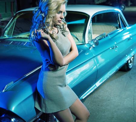 retro: Smart lady next to the retro car
