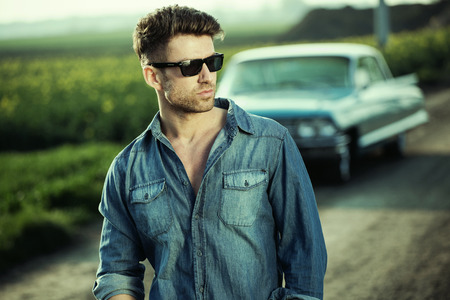 village man: Smart man wearing trendy sunglasses Stock Photo