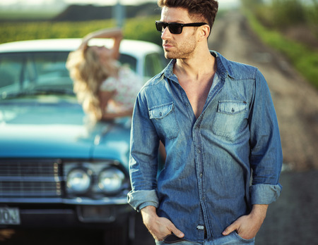 Handsome man wearing trendy sunglasses photo