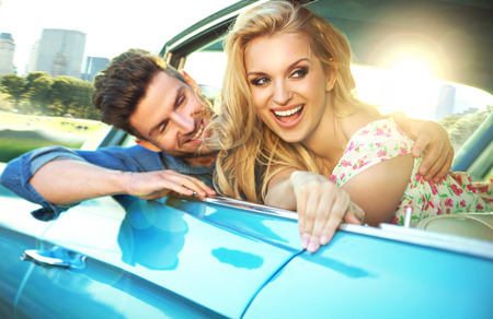 Cheerful couple enjoying the fast ride Stock Photo
