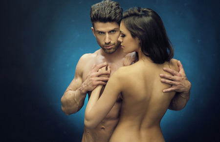nude lady: nude couple touching their fit bodies Stock Photo