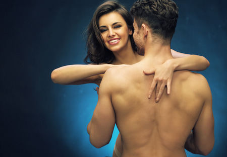Cheerful young lady with her shirtless muscular lover photo