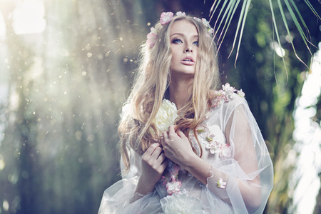 Gorgeous delicate lady with the sun beams in the background photo
