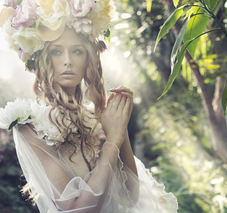 Blond woman with the fancy flower hat