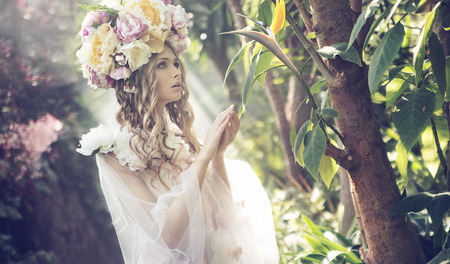 Portrait of the young blonde in the colorful jungle photo