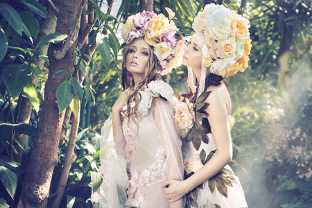 Two young forest nymphs weraing fancy hats Stock Photo