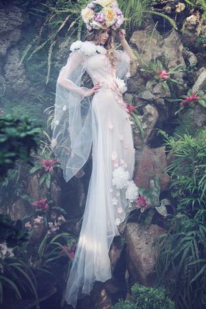 Delicate pale nymph dressed in bright dress Stock Photo