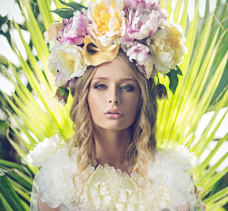 Portrait of the beautiful lady with flowery hat photo