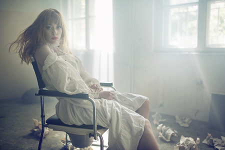 Portrait of the young pale lady in the old hospital photo