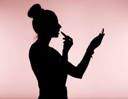 Attractive young lady with bun hairstyle Stock Photo - 29748450