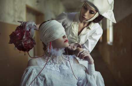 Blind patient and nurse in the old creepy hospital  photo