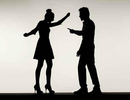 argument from love: Two fighting silhouettes of the young marriage couple Stock Photo